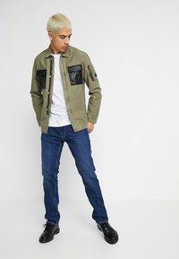 Replay - NEWBILL  - Straight leg jeans - medium blue - 1