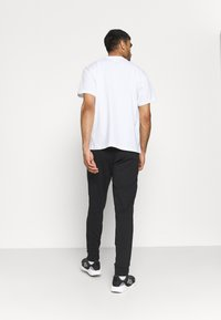 adidas Performance - Träningsbyxor - black/white - 2