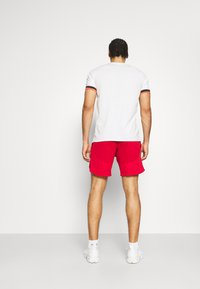 Under Armour - Sports shorts - red - 2