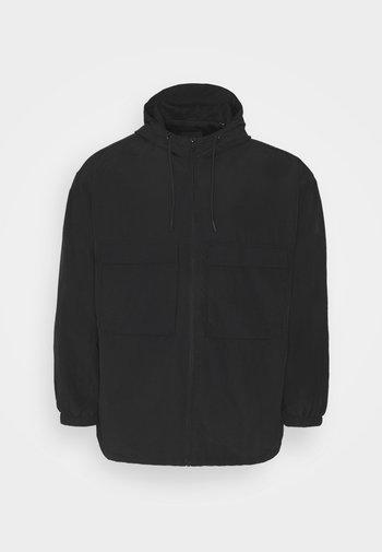 OVERSIZED ANORAK - Summer jacket - black