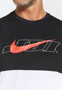 Nike Performance - TANK DRY ENERGY - Sports shirt - white/bright crimson - 4