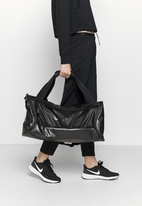 Nike Performance - DUFF UNISEX - Sports bag - black/black/black - 1