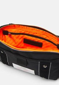 Diesel - DRESSLEK UNISEX - Bum bag - black - 2