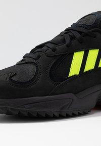 adidas Originals - YUNG-1 TRAIL - Sneakers - core black/solar yellow/aqua - 5