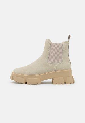 TUSK - Platform ankle boots - beige