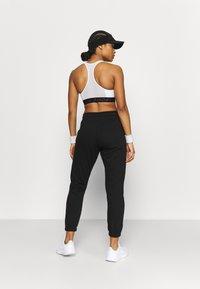 Cotton On Body - LIFESTYLE GYM TRACK PANTS - Pantalones deportivos - black - 2