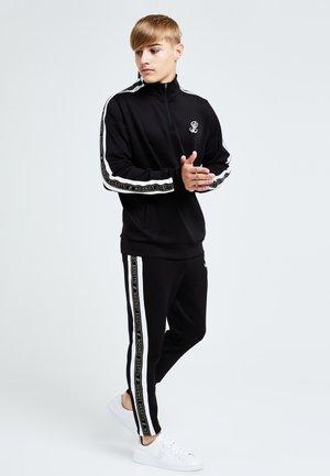 DIVERGE  - Teplákové kalhoty - black gold  white