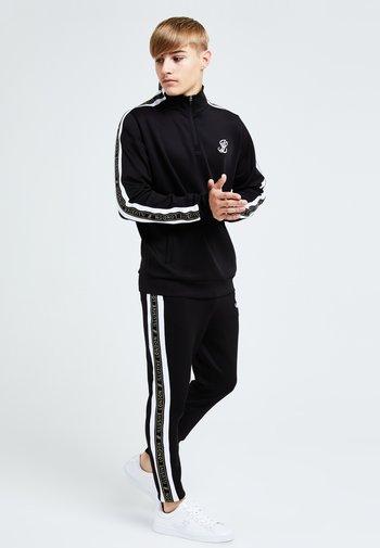 DIVERGE  - Pantaloni sportivi - black gold  white