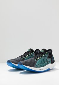 New Balance - FUELCELL REBEL - Neutral running shoes - black - 2
