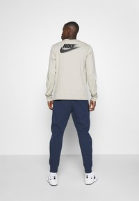 Nike Sportswear - M NSW TCH FLC JGGR - Träningsbyxor - midnight navy/black - 2