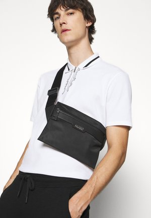 LUXOWN MINI UNISEX - Across body bag - black