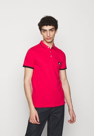 CÔTE D'AZUR - Polo shirt - red