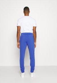 Nike Sportswear - SUIT BASIC - Chándal - astronomy blue/white - 5