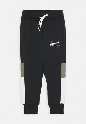 ALPHA SWEATPANTS - Verryttelyhousut - black