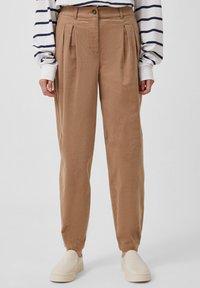 Finn Flare - Trousers - dark beige - 1