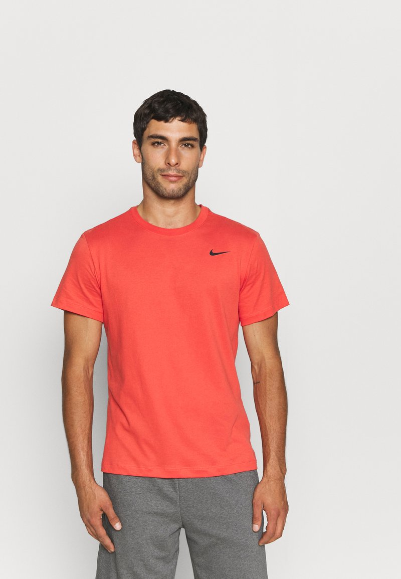 Nike Performance - TEE CREW SOLID - Basic T-shirt - lobster/black