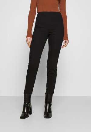 RIKA TROUSERS - Bukser - black