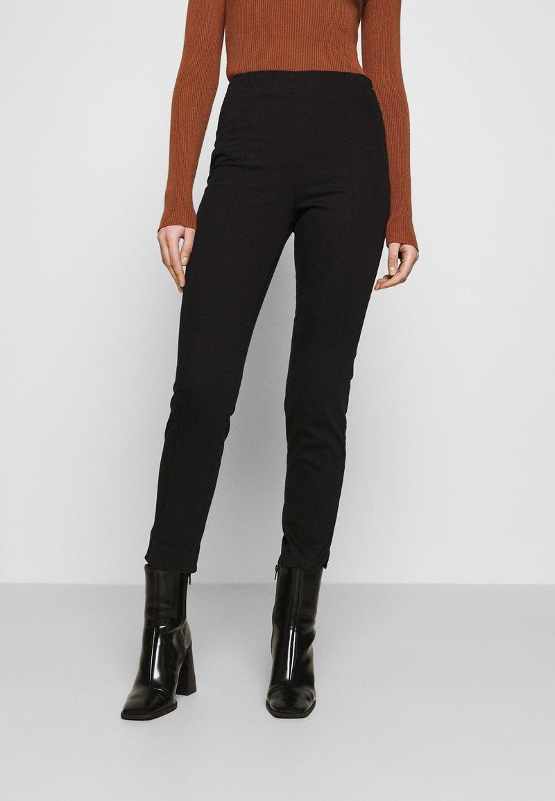 Monki - RIKA TROUSERS - Trousers - black