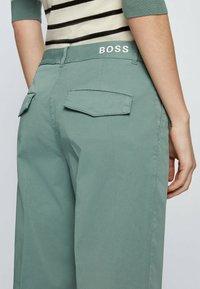 BOSS - TAROMA - Trousers - light green - 3