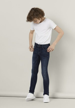 POWERSTRETCH - Slim fit jeans - dark blue denim