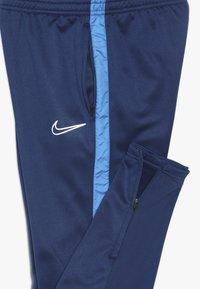 Nike Performance - ACADEMY WINTERIZED - Tracksuit bottoms - coastal blue/photo blue/reflective silver - 3