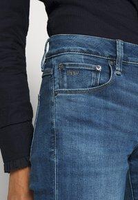 G-Star - 3301 MID BOOTLEG - Jeans bootcut - medium indigo - 4