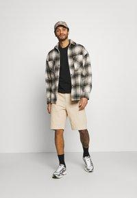 Karl Kani - Denim shorts - sand - 1