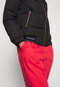 Calvin Klein - LOGO PUFFER JACKET - Winter jacket - black - 3