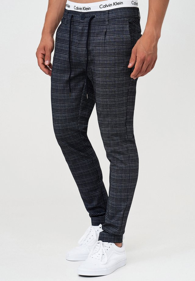 SUPER STRETCH DYER - Trousers - check