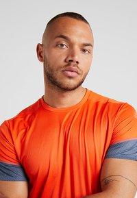 adidas Performance - TEE  - Print T-shirt - orange - 3