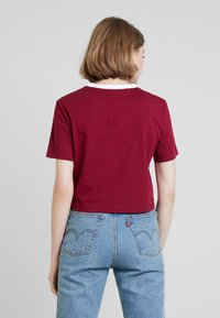 Calvin Klein Jeans - MONOGRAM EMBROIDERY RINGER TEE - Print T-shirt - beet red - 2