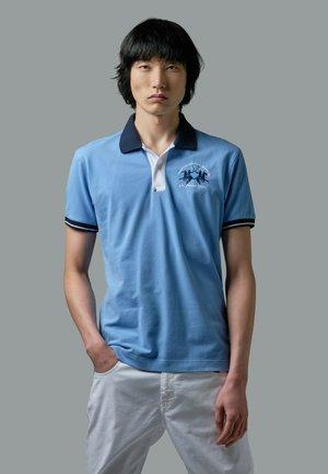 ROMALDO - Polo shirt - light blue