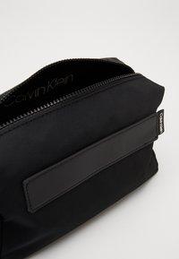 Calvin Klein - NASTRO LOGO WASHBAG - Wash bag - black - 4
