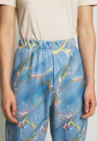 NEW girl ORDER - MARBLE  - Spodnie treningowe - blue - 4