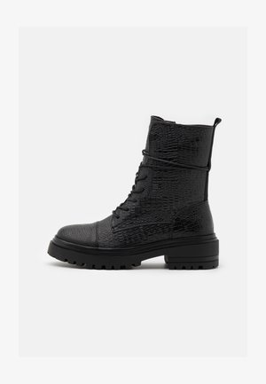 PETRONA - Platform ankle boots - black