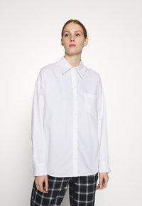 Monki - MEJA FANCY SHIRT - Button-down blouse - white solid - 0