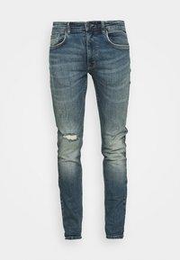 STOCKHOLM DESTROY - Slim fit jeans - rex indigo
