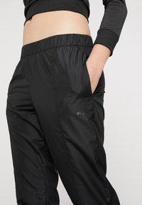 Puma - WARM UP PANT - Pantalones deportivos - puma black - 4