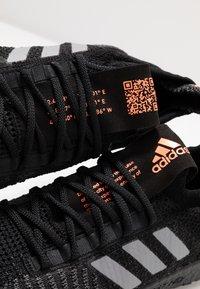 adidas Performance - PULSEBOOST HD - Zapatillas de running neutras - core black/grey three/signal coral - 5