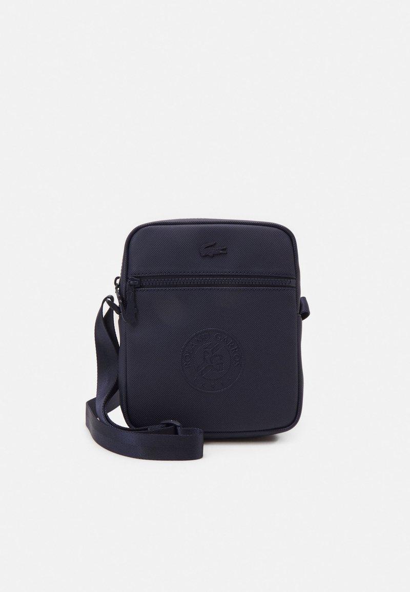 Lacoste Sport - VERTICAL CAMERA BAG - Across body bag - marine