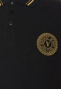 Versace Jeans Couture - PLAIN  - Polo shirt - black/gold - 6