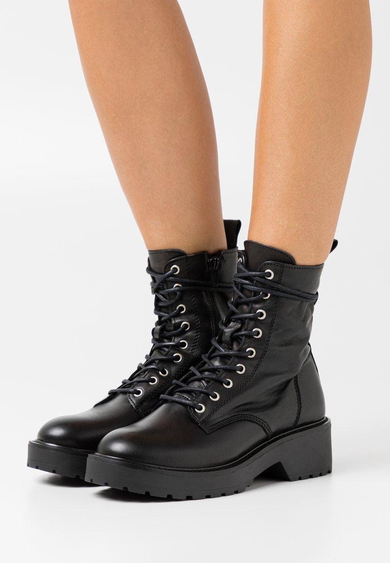 Steve Madden - TORNADO - Lace-up ankle boots - black