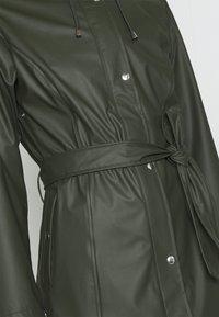 KnowledgeCotton Apparel - JASMINE LONG RAIN JACKET - Waterproof jacket - forrest night - 4