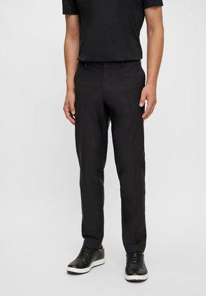 ELLOTT GOLF - Spodnie materiałowe - black
