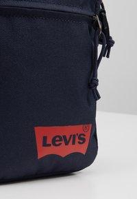 Levi's® - MINI CROSSBODY SOLID BATWING - Across body bag - navy blue - 2
