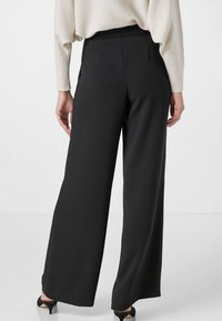HALLHUBER - LOOSE FIT - Trousers - black - 1