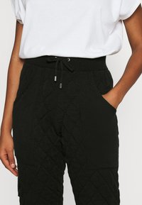Topshop - QUILTED - Tracksuit bottoms - black - 4