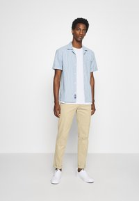 Tommy Hilfiger Tailored - FLEX SLIM FIT PANT - Trousers - beige - 1