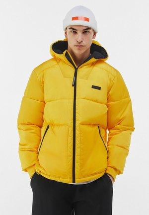 Talvitakki - yellow