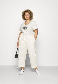 Nike Sportswear - CLASH PANT - Trousers - coconut milk - 1